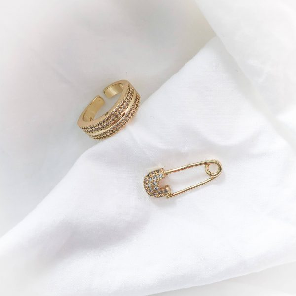 Brass with real 18k gold plated, cubic zirconia.