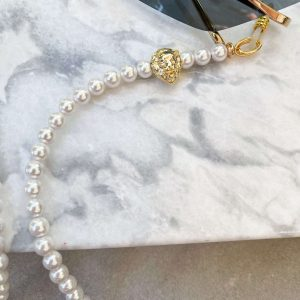 Shell pearl, leopard — brass with cubic zirconia.