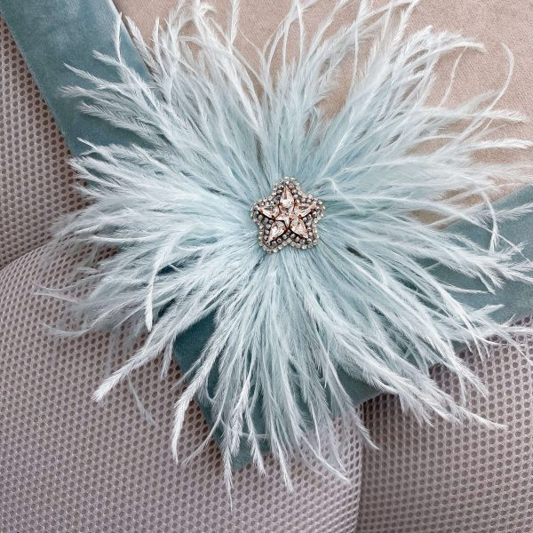 Real leather, ostrich feathers, Swarovski crystals, rhinestone chain, glass beads.