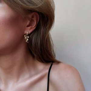 Brass ear stud with cubic zirconia, real gold 18k plated, for pierced ears.