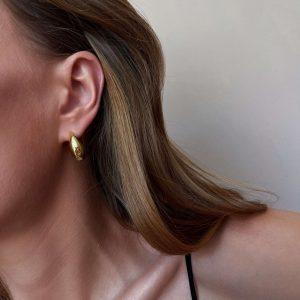 Brass, for pierced ears.